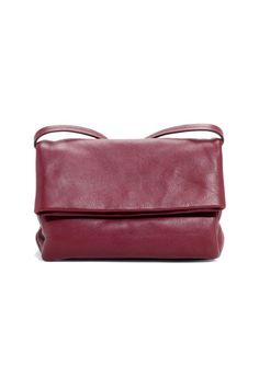 A raspberry fold-over bag in buttery-soft leather that's fully lined so it's equipped to handle all the eyeliner/pen/food spillage you can think to inflict on it.   Fold-Over Leather Crossbody, $195; stories.com.