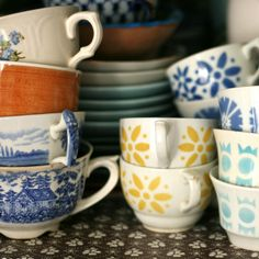 Give a mug, take a mug (Have a basket of mugs that customers can trade out with a mug from home).