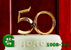 Wilton item number 1008-762. Visit www.GalesWholesale.com for more information. Gold 50th Anniversary Pick - 5.25in h (13.3cm) inc. Proudly display the number of years married! Appointed in rhinestones, a sparkling pick makes a beautiful keepsake for the honored couple. Use as a cake topper and in floral arrangements, bouquets and centerpieces. Food Safe. Gold plated.