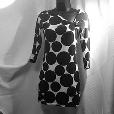 By Express VERY FIGURE FLATTERING!  Slant neck gathered at left shoulder Length 27 in 3/4 sleeves  57% Prima Cotton  38% Modal  5%   Spandex   Cute as dress alone or with Leggings.  Let it be yours today! Express Dresses Mini