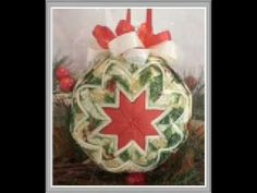 Handmade Quilted Fabric Ornaments -  Some beautiful examples of the folded square stars Christmas balls.  This is a great fabric scrap buster and can be personalized to make lovely gifts for the holidays.