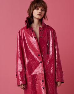 Peyton Knight models LRS patent leather coat