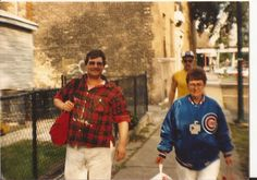 Larry Bierchen & his mother Toni (both were comm workers at Wrigley). Here they're walking west on Waveland across from the ballpark. October 3, 1985..