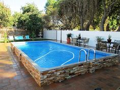Above ground pool ideas above ground swimming pool with deck above ground pool maintenance above ground pool landscaping hacks oval sunken designs steps Above Ground Pool Landscaping, Above Ground Pool Decks, Backyard Pool Landscaping, Above Ground Swimming Pools, In Ground Pools, Landscaping Ideas, Diy In Ground Pool, Backyard Ideas, Rectangle Above Ground Pool