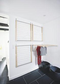 De væghængte tørrestativer fra Ikea er praktiske, fordi de ikke optager plads, når de ikke er i brug.