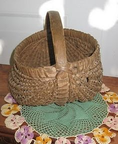 Old egg basket! i love this shape!  Papaw and Granny made us one like this when we were kids.