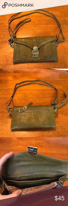 Green wallet bag This wallet is a three in one! Can be worn as a shoulder bag, wristlet, or wallet! Just slide the lock down the open this wallet, so fun it feels like a magic trick! Tons of pockets inside with a special plastic window for license! Pockets on back and front! All straps detachable. Never used De De Bags Wallets