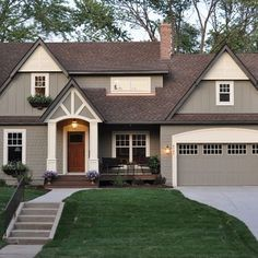 House exterior color, would look great with dark oak garage door and front door. Note, black window boxes. Black shutters work?
