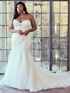 5177afca2241 This bride is wearing Quincy by Maggie Sottero, a heart-shaped, strapless  gown with elegant beading and a graceful train. It will definitely make any  ...