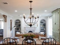 A wall was removed to bring more space and light into newly combined dining room and living area. Antique furnishings and wooden corbels bring a refined look and a visual tie-in with the interiors at the B