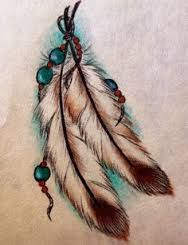 pretty feathers and like the crossed placement & beads