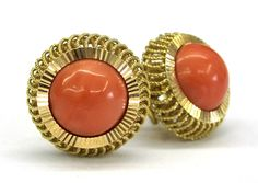 Ladies 18kt  yellow gold coral earrings. Set in earrings are 2 round shape coral gemstones. Earrings are bezel set in a fancy 18kt yellow gold mounting and have omega backs with posts.