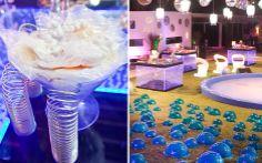 Pote com designer futurista e bolas azuis espalhadas pelo jardim