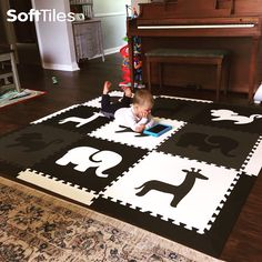 """""""Big Brother loves his new SoftTiles that he'll be sharing with Little Brother upon his arrival in a few weeks. The quality is awesome!""""  SoftTiles Safari Animals Safari Animals Black, Gray, and White with sloped borders."""