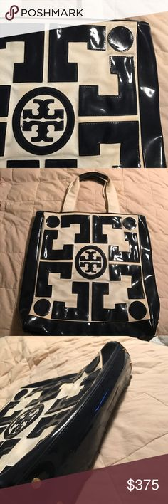 """Tory Burch Navy Patent & Cream Canvas Large Tote This. Bag. Is. FABULOUS!!! I'm in L❤VE! Fantastic Tory detail in the patent pattern & stitching. Four gold studs to protect the bottom. This is a large Tote and will hold everything! Not too big to carry for every day but big enough to carry a laptop & accessories or anything else! Carried a few times. Minor scuffles as shown in pics. Not noticeable unless in light. Canvas is clean. Has zipper pouch inside. 13"""" wide x 15"""" high x 4"""" sides with…"""