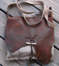 Primitive Mountain Man Hunting Pouch Possibles Bag by misstudy, $95.00 Closure is blacksmith made ring with a coyote foot bone toggle.