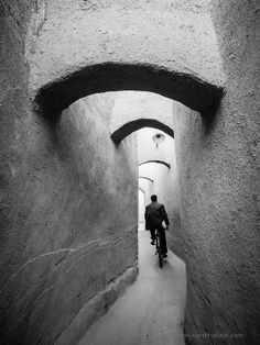 Yazd, Iran ((I have been there and the streets are literally this narrow, YET PEOPLE STILL DRIVE CARS AND RIDE MOTORCYCLES THROUGH THEM))