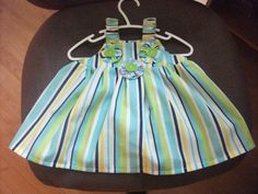 dress made for my granddaughter Natalie.....basic pattern with yoyo flower embellishments