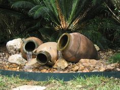 Bubbling Containers An easy way to create an inexpensive fountain is to convert a garden pot — any size — into a bubbling water feature.