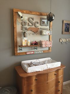 My sons nursery. We made a Peg board changing station. Ordered standard peg board baskets for storage. Made a shelf from pipe parts and a distressed wood.