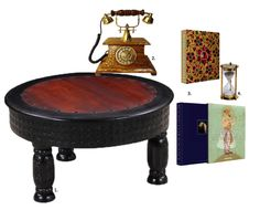 If you want a vintage Indian look, style this mango wood coffee table with the Maharaja telephone and sand timer. Beyond Extravagance, a hefty tome of a coffee table book, will provide some interesting reading material for your guests to flip through. Add small accessories that can work as statement items for your table. To shop these products, read our blog!