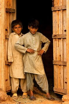 Nice young teenager friends around 13 years seems be happy in the barn where they play and have fun, Pakistan