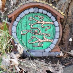 i need a hobbit door for our red maple! Hobbit/Fairy Door by HiddenWorlds on Etsy Fairy Garden Doors, Fairy Garden Houses, Fairy Doors, Fairy Gardens, Miniature Gardens, Hobbit Door, The Hobbit, Magic Garden, Garden Art