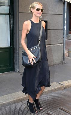 Heidi Klum accessorized a simple black midi dress with badass open-toe booties, a chic satchel and square aviators with gold flash lenses!