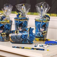 Batman cups pull double duty as favor containers! Fill them with fun favors, slip each cup into clear plastic bags & tie them with curling ribbon for an impressive looking favor!