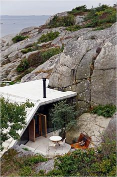 Tiny Modern Cabin In Norway Serves Up Style On The Rocks | This tiny modern cabin by <strong>Lund Hagem Architects</strong> was built among large rocks and thick vegetation in Sandefjord, Norway. The 322-square-foot retreat, an extension of an existing home on the site, replaces two old sheds.<!--more-