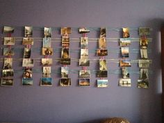 How I display photos on the wall above my couch. And so easy to change em out!