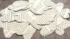 Vintage Book Heart Confetti - 100 Pieces. This is a GREAT alternative to centerpieces! Put down a square or octagon mirrored tile with a candle in the middle, sprinkle some heart confetti and/or flower petals on the table, et voila! instant centerpiece without the expense of flowers on every table (besides... the only flowers that really show in the pictures are bouquets and boutonnieres anyway!) Then, instead of numbering each table, you can name then the Bride and Groom's favorite novels! Book Centerpieces, Vintage Centerpieces, Centrepieces, Centerpiece Ideas, Chic Wedding, Wedding Stuff, Octagon Mirror, Flower Petals, Flowers