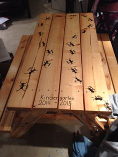 Handmade picnic table with fingerprint ants made by kindergarten kids, for school auction