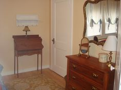 Vintage furnishings in the master bedroom