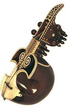 Sarinda is constructed out of a combination of wood and bamboo. The instrument… Mandolin, Musical Instruments, Musicians, Bamboo, Wood, Music Instruments, Madeira, Woodwind Instrument, Instruments