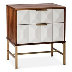 • Wood frame with a warm finish<br>• Faceted drawer faces in white<br>• 2 easy-glider drawers<br>• Metal hardware with a metallic gold finish<br><br>The 2-Drawer Studded Nightstand from Nate Berkus offers a mix of textures and tones to create a unique piece of modern furniture. Pair 2 of these bedside tables around a bed for a sophisticated look.