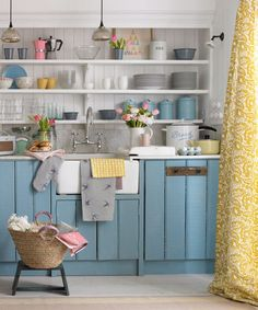 This country kitchen with open shelving is certainly not one for minimalists! The curtains perfectly complement the blue painted cabinets, along with the accents of pink. Kitchen Cabinets And Cupboards, Kitchen Units, Painting Kitchen Cabinets, Kitchen Paint, Home Decor Kitchen, Kitchen Furniture, Home Kitchens, Small Kitchens, Kitchen Walls