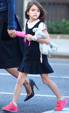 "It's a ""walk-to-school"" at The Avenues School! Suri Cruise walks to school on September 25th 2013. Suri was wearing Pleated Hem Bl..."