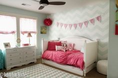 Big Girl Room featuring a subtle chevron accent wall