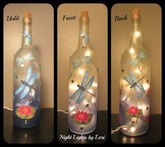 Dragonfly Wine Bottle Night Light. Bottom half of this bottle is slightly blue to represent water. Strand of 20 mini lights inside. Hole drilled in back of bottle The bottle is decorated all around in dragon flies and lily pads. Night lights can be left on all night as the glass
