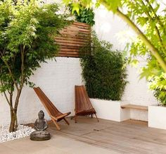 A planter of bamboo and a petite Japanese maple, along with a simple wood-slat trellis and minimalist furniture, create a peaceful space in which to unwind. A palette of white, natural wood, stone and lush greenery helps boost feelings of relaxation. Choose smooth river stones as mulch, and just one meaningful sculpture or icon.