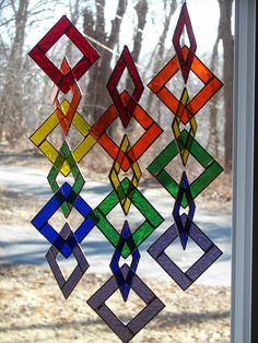 Hey, I found this really awesome Etsy listing at https://www.etsy.com/listing/201120744/stained-glass-rainbbw-chain-suncatcher