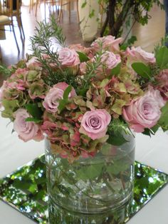 Column vase arrangement with roses, hydrangeas and herbs by Euphoric Flowers
