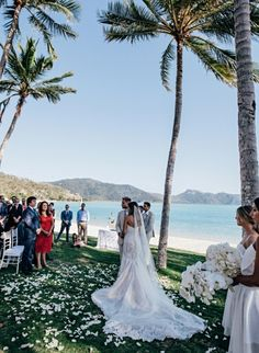 Inside a picture perfect tropical island wedding: Venue: One&Only Hayman Island Photographer: Elise Hassey Videographers: Jake Terrey and Hannah Dougherty Bride & Groom: Natalia and Tim