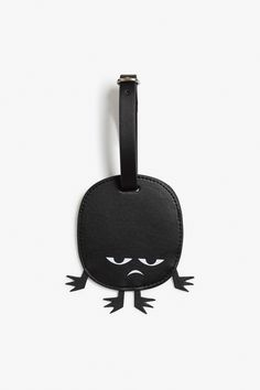 """""""No touch-y!"""" says the face of your Ikmo travel tag, watching out for you and your stuff."""