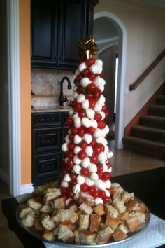 Caprese Christmas Tree  Insert cherry mozzarella balls with a toothpick in a Styrofoam cylinder alternating with cherry tomatoes. Drizzle wilth EVOO, salt, and pepper. Garnish with Some fresh basil and add some focaccia bread or croutons as the tree skirt! Buon Appetito! From Cathy's Creations :)