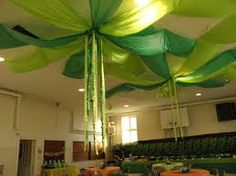 If you're looking for an easy decorating idea that takes up a lot of space, here's one! Just take two different colored plastic tablecloths from the dollar store and drape them from a center point...                                                                                                                                                     Plus