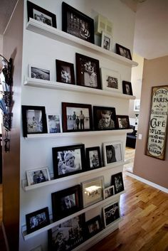 "GALLERY SHELVES: Whether it's one shelf or 10, simple gallery ledges can transform a blank wall into an easy to display gallery. Ledges require less nails (imagine ""nailing"" all these frames on the wall) and offer ability to swap photos and art work in and out at will.     For step by step plans to build shelves, see  http://ana-white.com/2010/10/plans/ten-dollar-ledges"