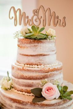 Rustic lakeside wedding cake with a wooden topper