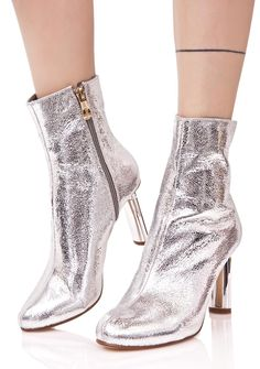 Lightscreen Ankle Boots are shootin' beams across the sky, babe! These gorgeous ankle booties feature a textured metallic silver construction, tapered toe, inner ankle side zip closure, and a chrome silver lighter shaped heel.